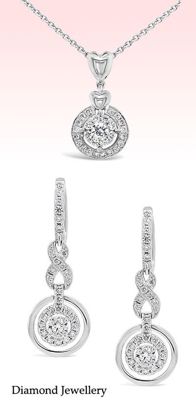 Banner Image 18k White Gold Diamond Pendant and Earring set